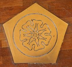 school symbol in peppercorn floor resized